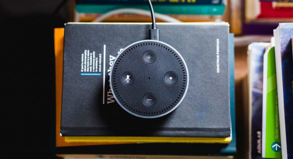 black Amazon Echo on black covered book